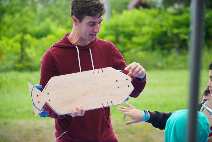 Tim King Ed Venture Holding A Handmade Skateboard