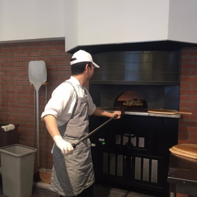 Mandriano Pizza Chef Putting Pizza In The Oven