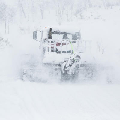 The House Of Powder's open-top snow cat in heavy snow fall.