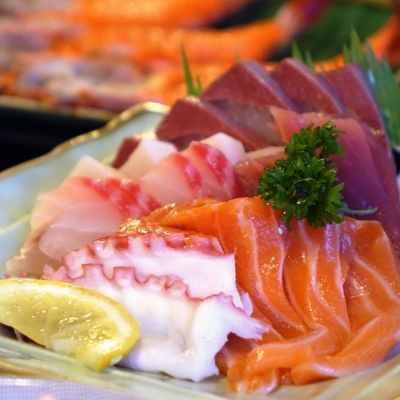 Raw, sliced fish a sashimi spread