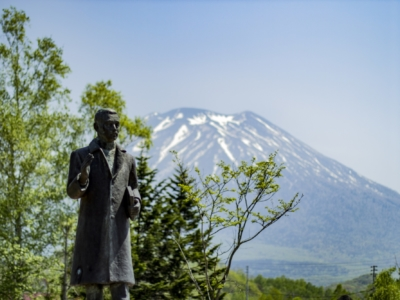 Takeo Arishima Statue At The Arishima Memorial Museum Mt Yotei Background Blue Skies May Spring