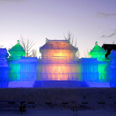 Spectacular sculpture lit up at night.