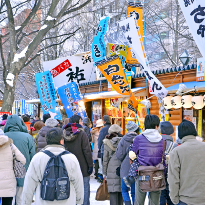 People strolling the many food stands at the festival.